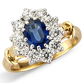 Oval Sapphire and Diamond Claw Set Cluster Ring With Fleur-de-Lys Shank