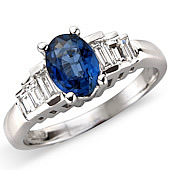 Oval Sapphire and Diamond Ring With Baguette Set Shoulders
