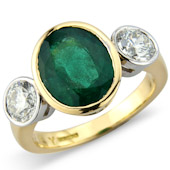 Oval Emerald and Diamond Rub Set 3-stone Ring