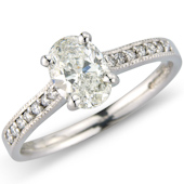 Oval Solitaire with Pave Set Shoulders