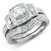 Deco Style Diamond 3-stone Cluster Ring with Baguette Set Shoulders.  (0.60ct)