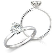 Brilliant Cut Twist Solitaire Ring in Double Claw Mount