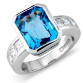 Chess Cut Blue Topaz (6.40ct) in a Rub Set Mount with Princess Cut Diamond (1ct) Channel Set Shoulders
